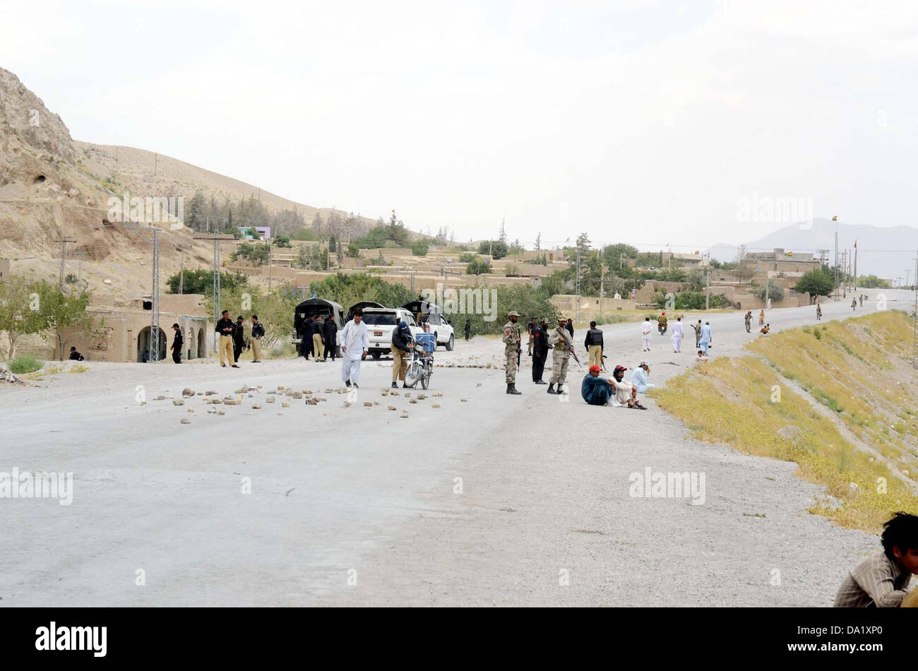 Security officials stand alert to avoid untoward incident while road seen closed during funeral prayer of for suicide - Stock Image