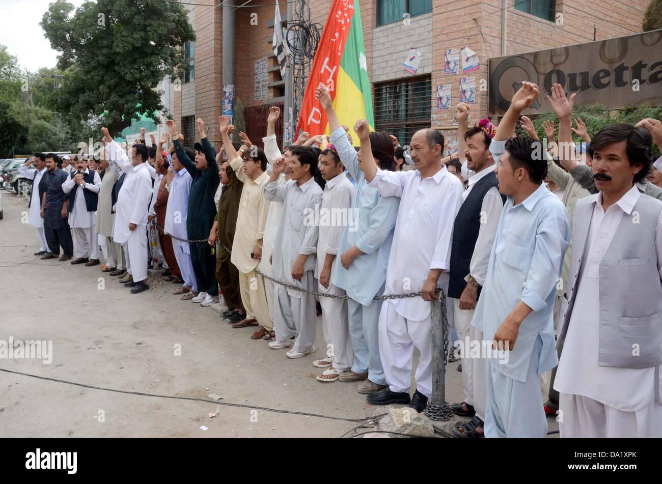 Activists of Hazara Democratic Party chant slogans against suicide bomb blast of Aliabad area in Hazara town on - Stock Image
