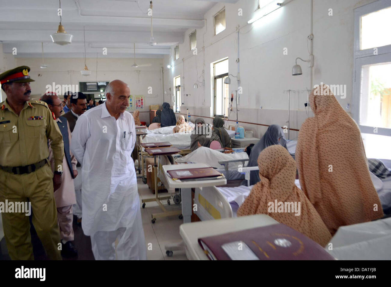 Balochistan Chief Minister, Dr.Abdul Malik Baloch enquires about health of victims of suicide bomb blast of Aliabad - Stock Image