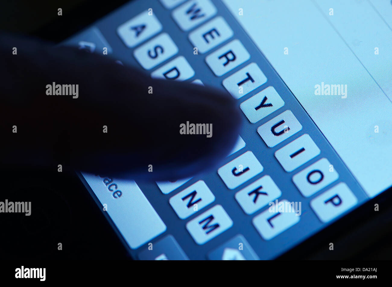 closeup finger on smart phone keyboard concept - Stock Image