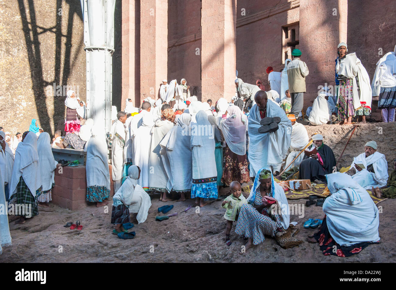 Pilgrims with the traditional white shawl attending a ceremony at the Bete Medhane Alem Church, Lalibela, Ethiopia - Stock Image