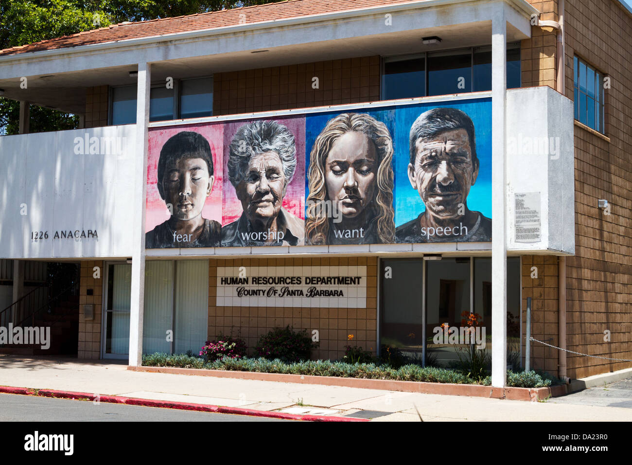 Exterior view of the Human Resources Department building in Santa Barbara, California showing a mural. - Stock Image