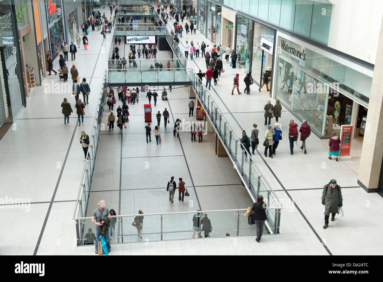 An internal shot of the busy Manchester Arndale shopping centre. - Stock Image