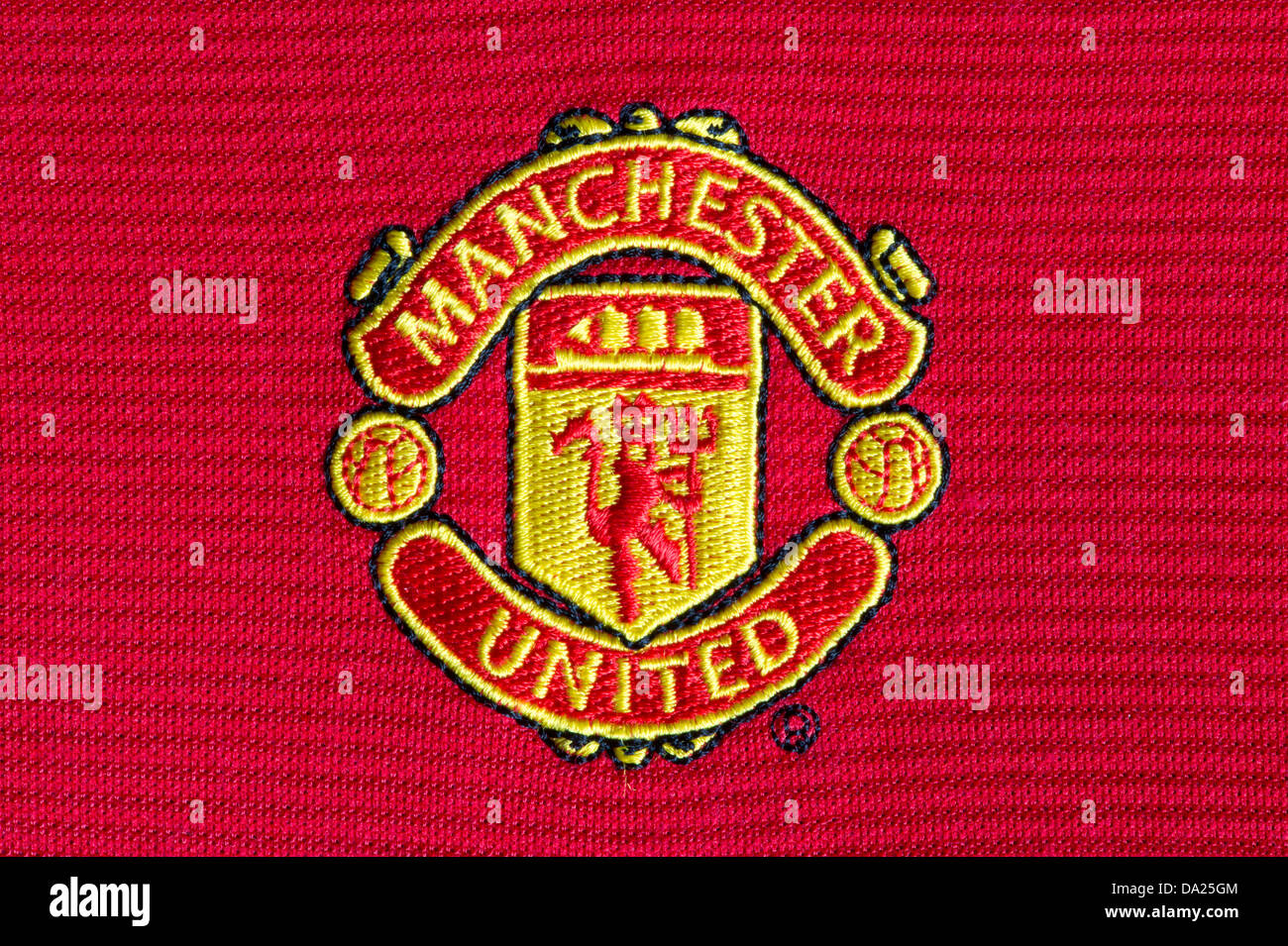 The Manchester United Football Club badge as seen on a playing jersey (Editorial use only). - Stock Image