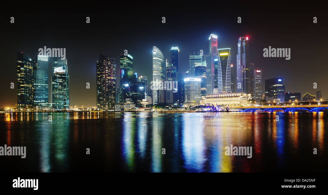 Night Singapore skyscrapers shines with electric lights - Stock Image