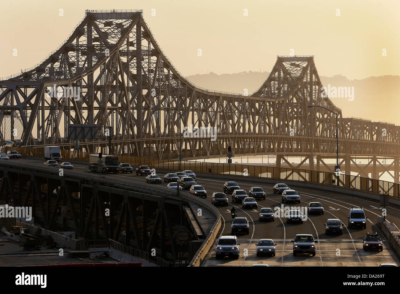 Traffic rolls across the San Francisco Oakland Bay Bridge, which has since been torn down and replaced. - Stock Image
