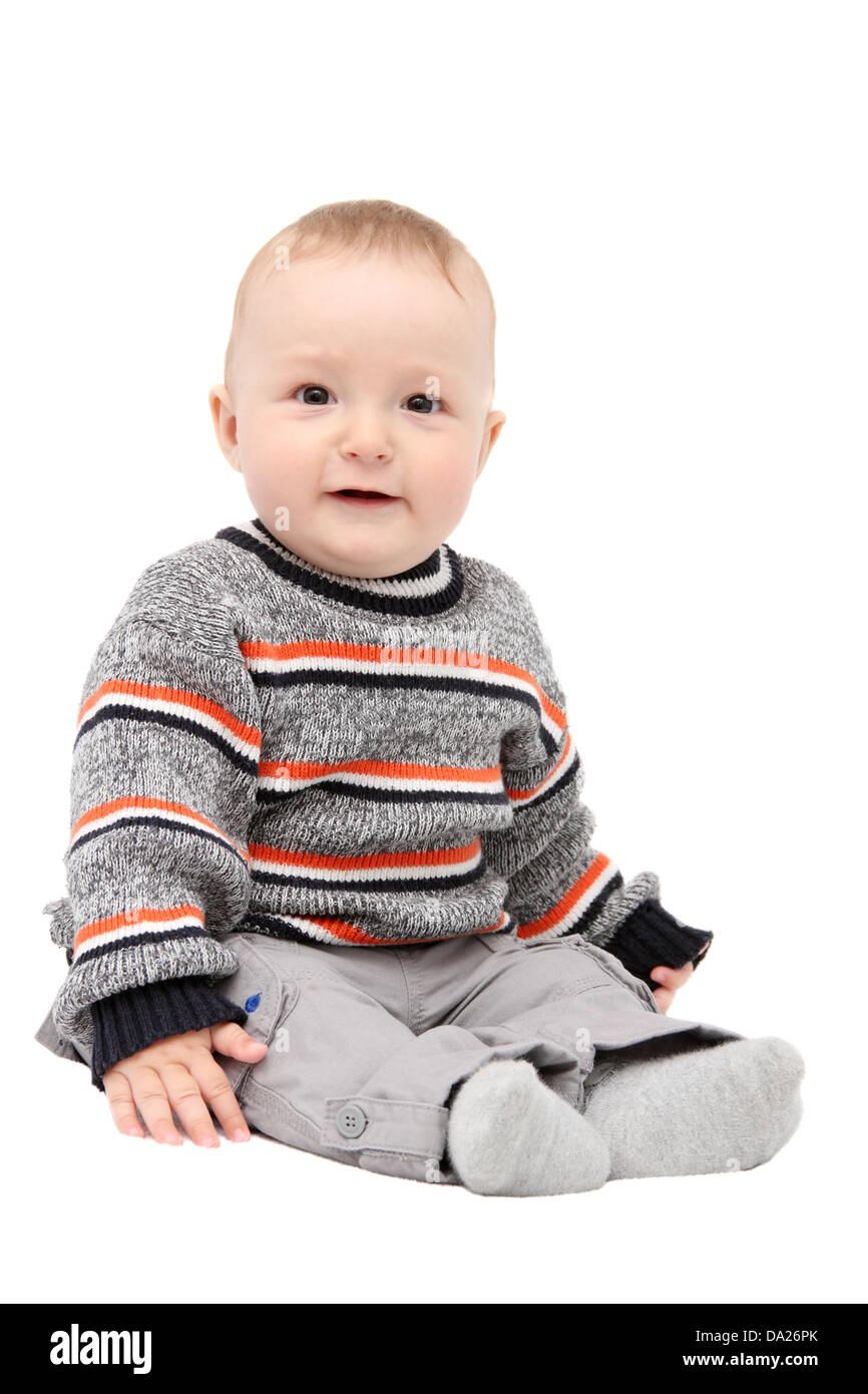 beautiful happy baby boy sitting on white background - Stock Image