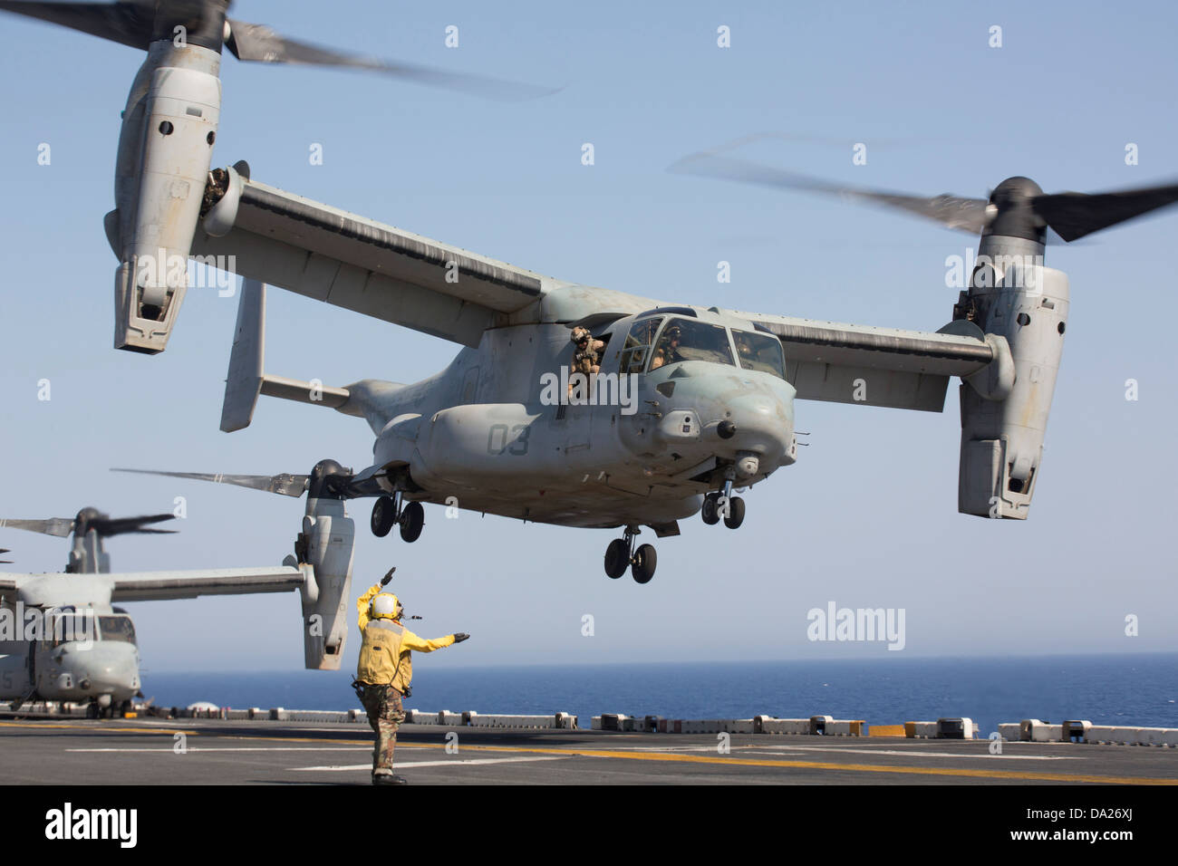 A US Marine Corps MV-22 Osprey aircraft takes off from the amphibious assault ship USS Kearsarge June 30, 2013 in - Stock Image
