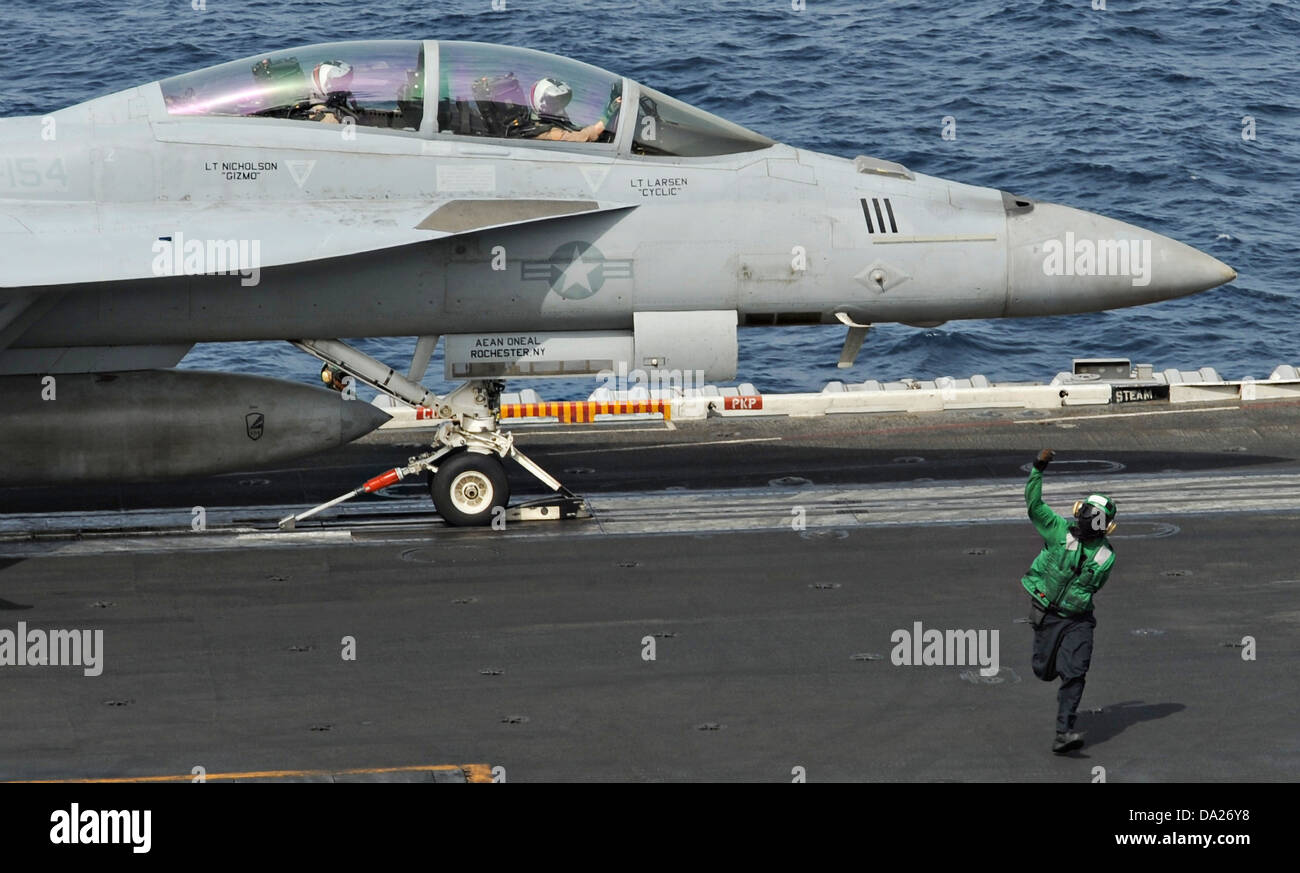A US Navy F/A-18F Super Hornet fighter aircraft prepares to launch from the aircraft carrier USS Nimitz June 29, Stock Photo