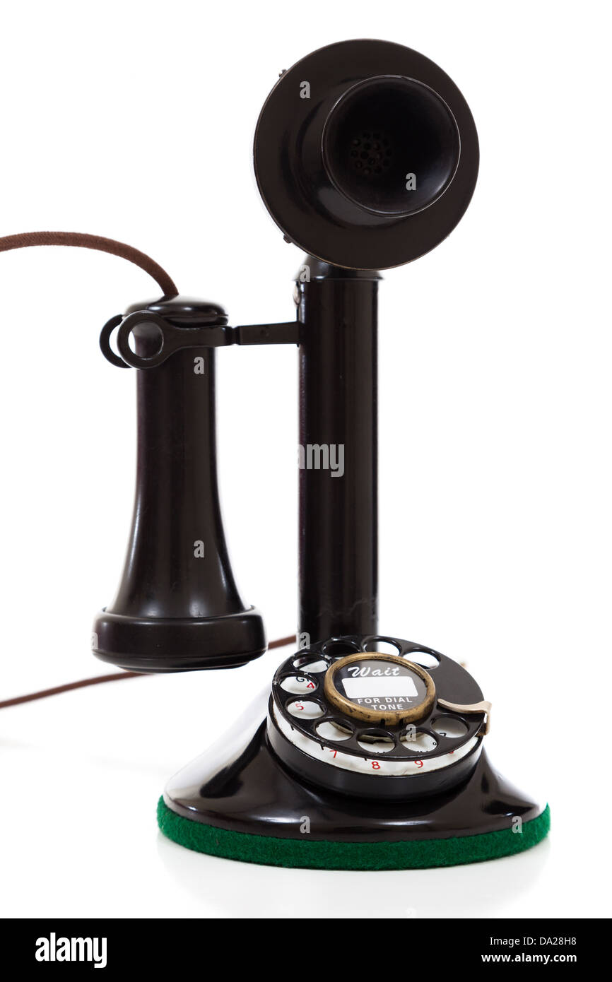 A Black vintage candlestick phone on a white background - Stock Image