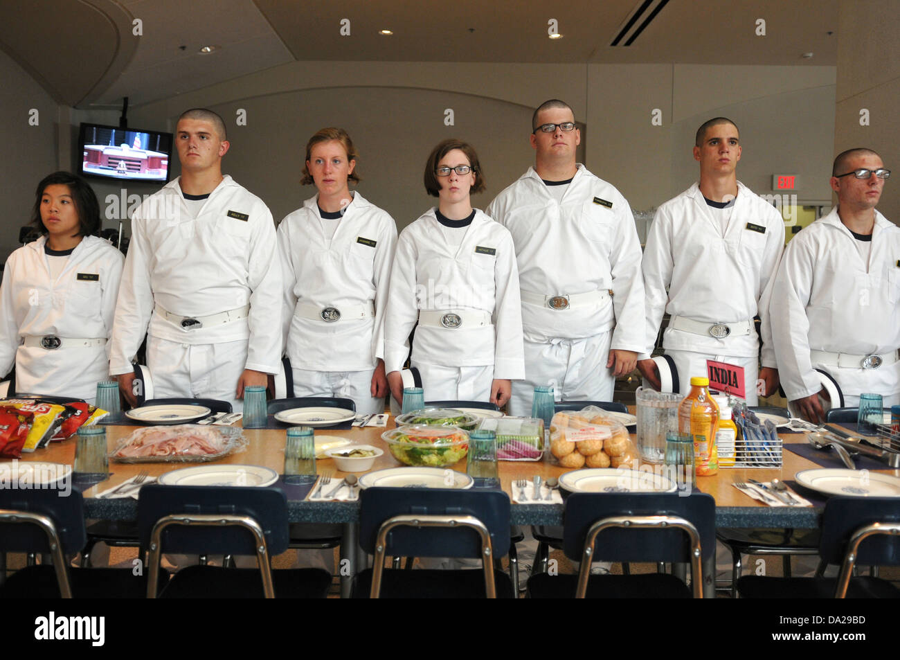 midshipmen from the us naval academy line up for a meal during stock