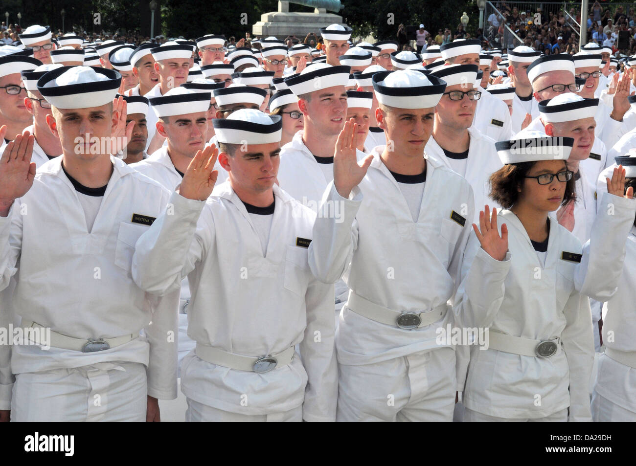 midshipmen from the us naval academy are sworn in during induction
