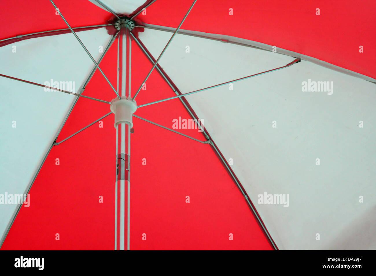 red white umbrella beach sun rain lifeguard lifeguards umbrellas weather forecast - Stock Image