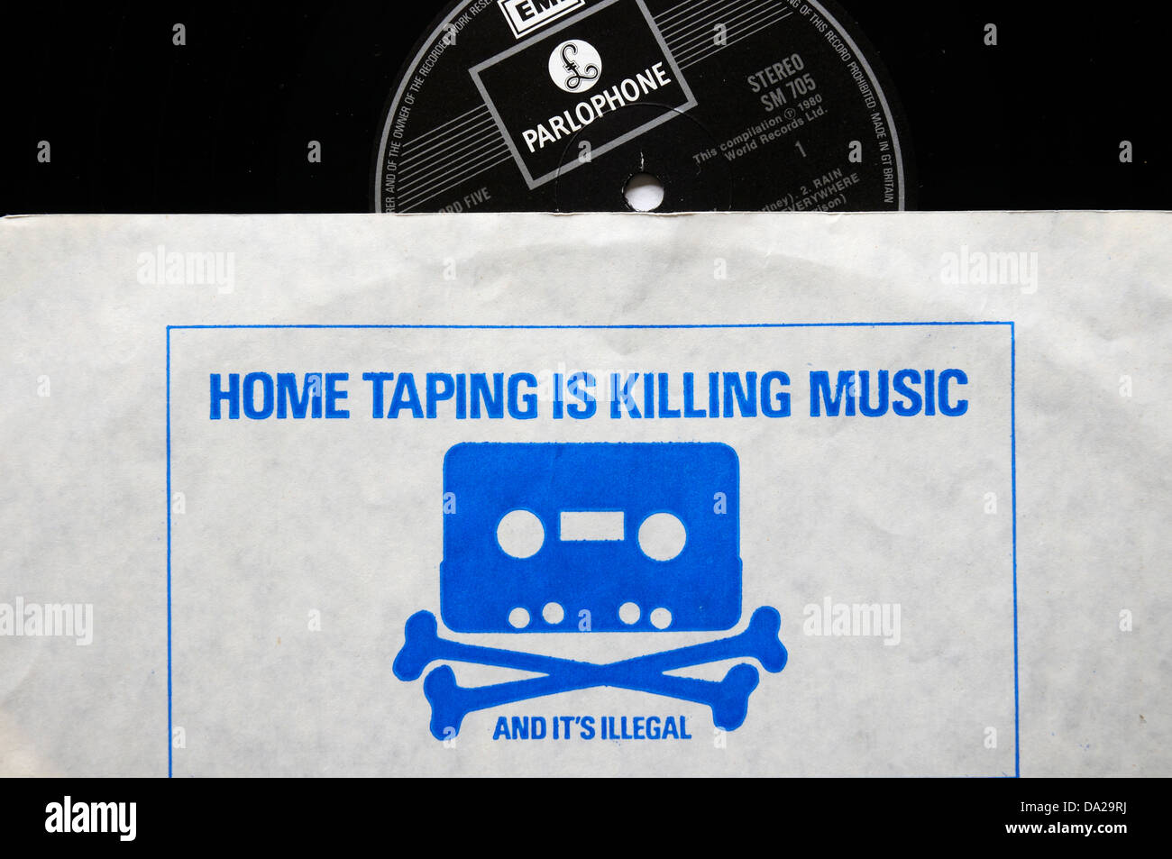 A printed warning on a record inner sleeve saying 'home taping is killing music' - Stock Image