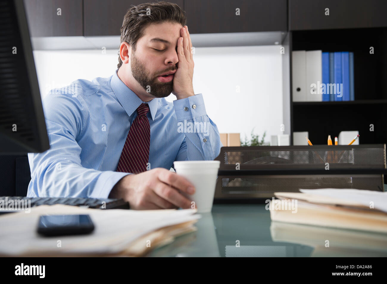 Portrait of overworked man - Stock Image