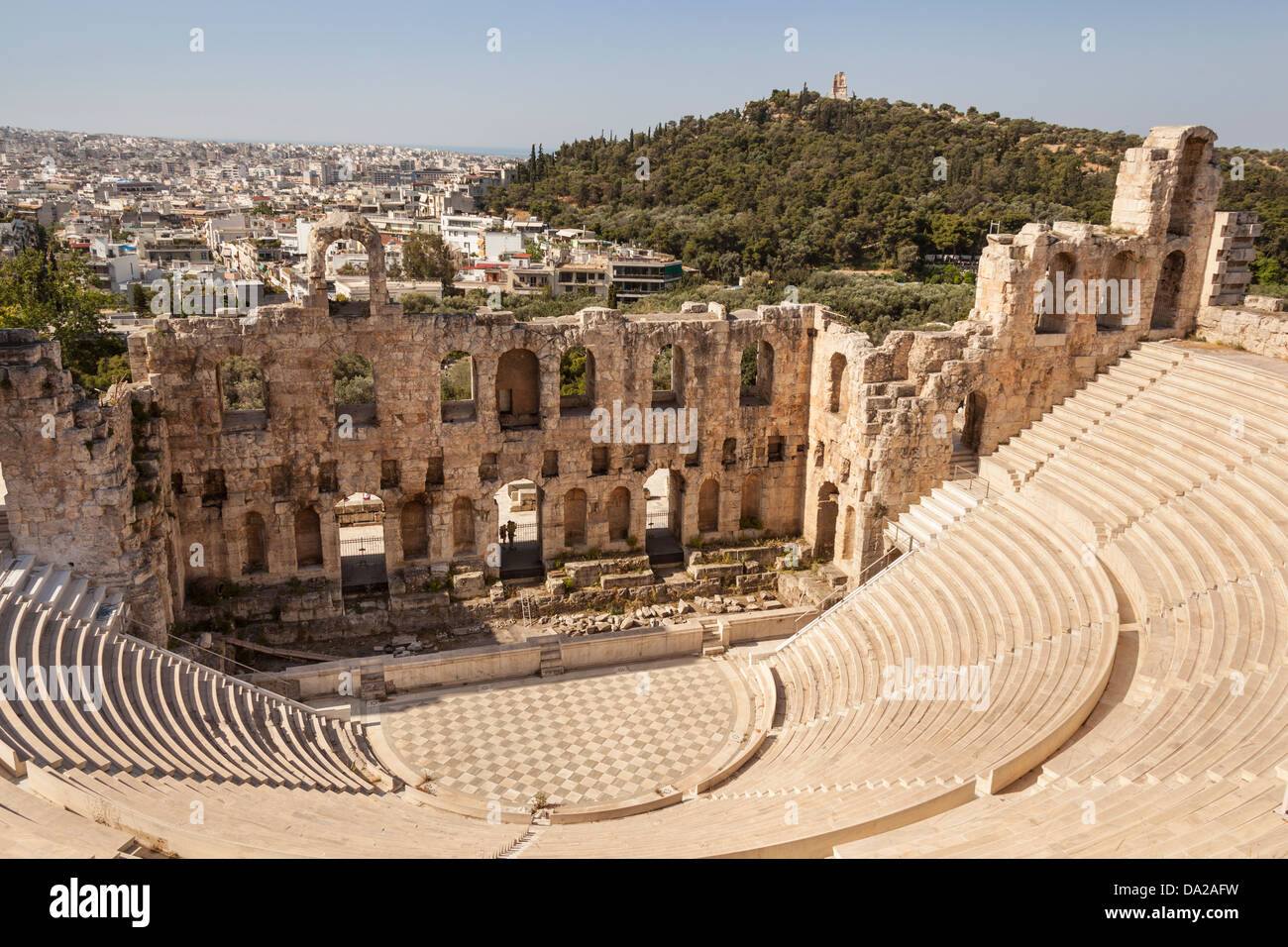 Odeon of Herodes Atticus at the Acropolis and Filopappos Monument on Filopappos Hill in background, Athens, Greece Stock Photo
