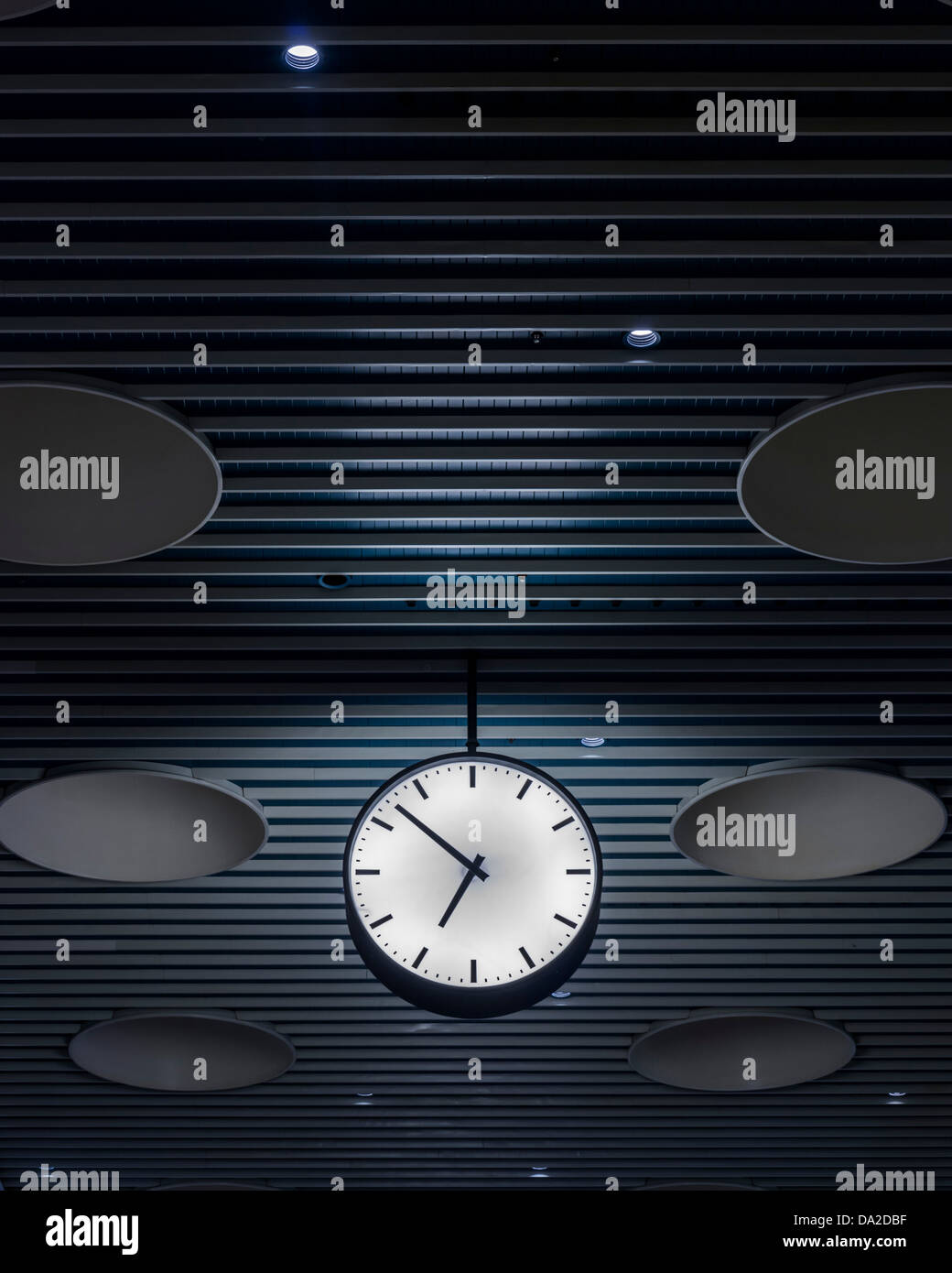 Copenhagen Airport, Copenhagen, Denmark. Architect: Vilhem Lauritzen, 1998. Ceiling and clock, Terminal 2. Stock Photo