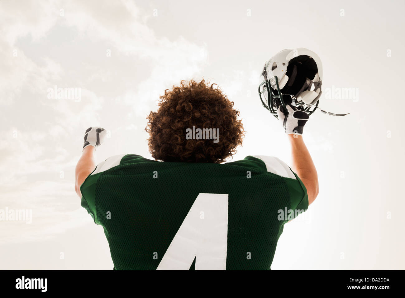 Portrait of American football player celebrating victory - Stock Image