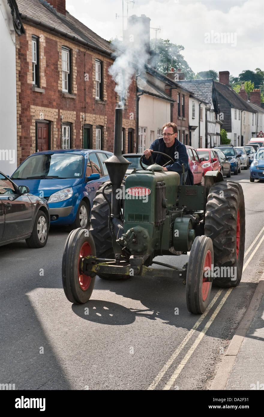 Presteigne, Powys, UK. A Marshall tractor leaving the annual vintage vehicle rally. This is a Type M from about - Stock Image