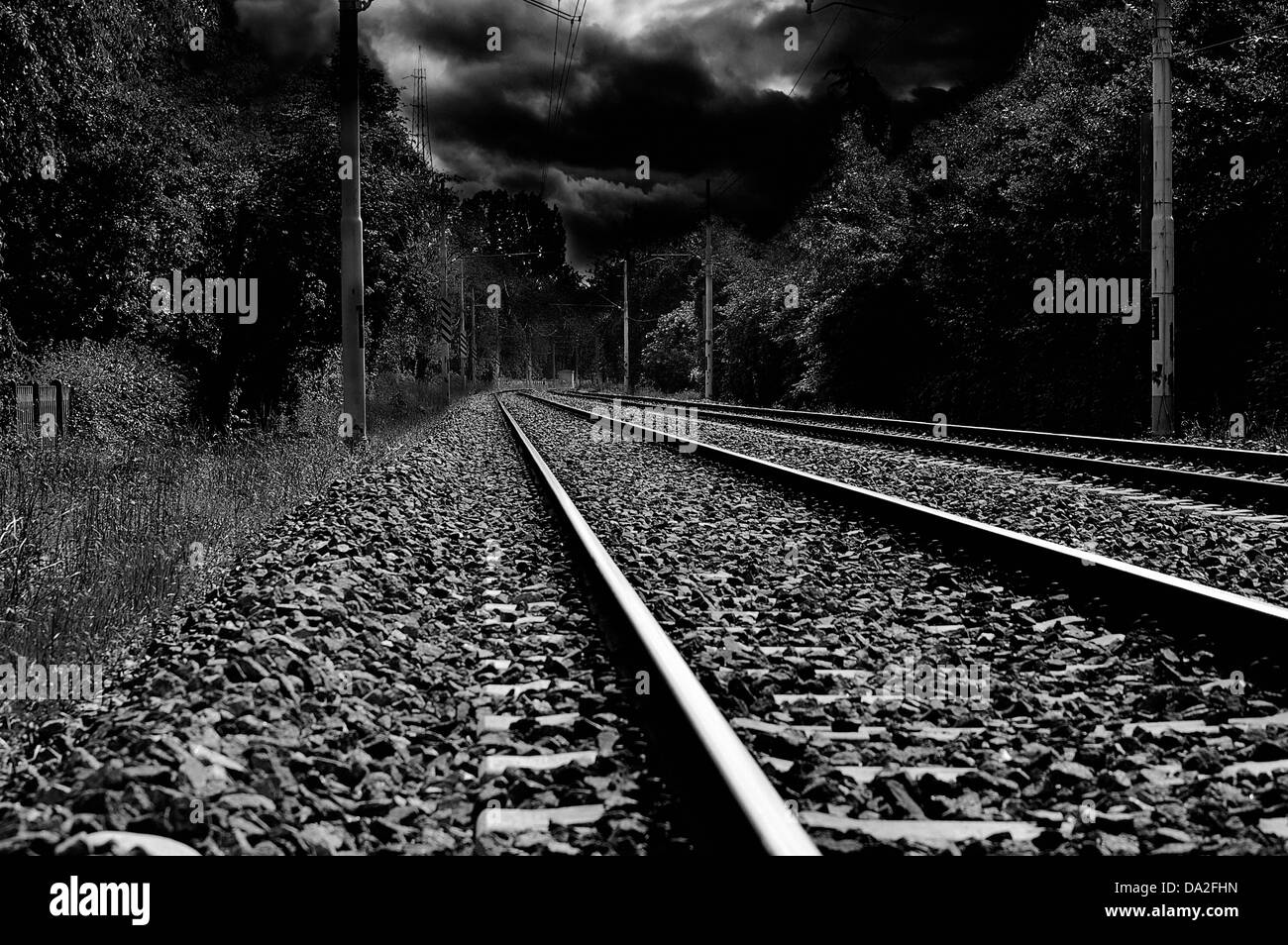 railways track and a stormy sky in background - Stock Image
