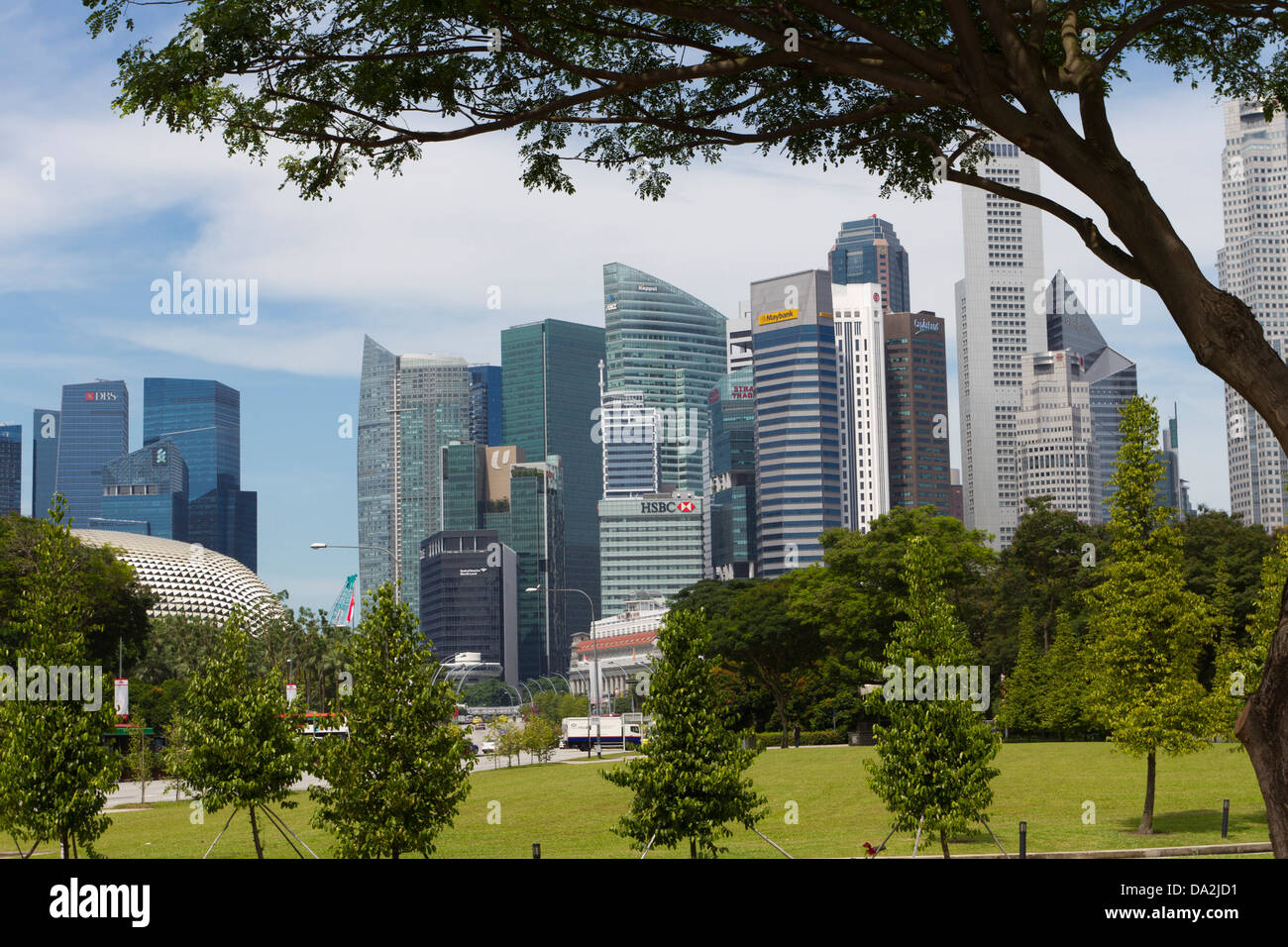 Financial/business district and banks framed by trees, Singapore - Stock Image