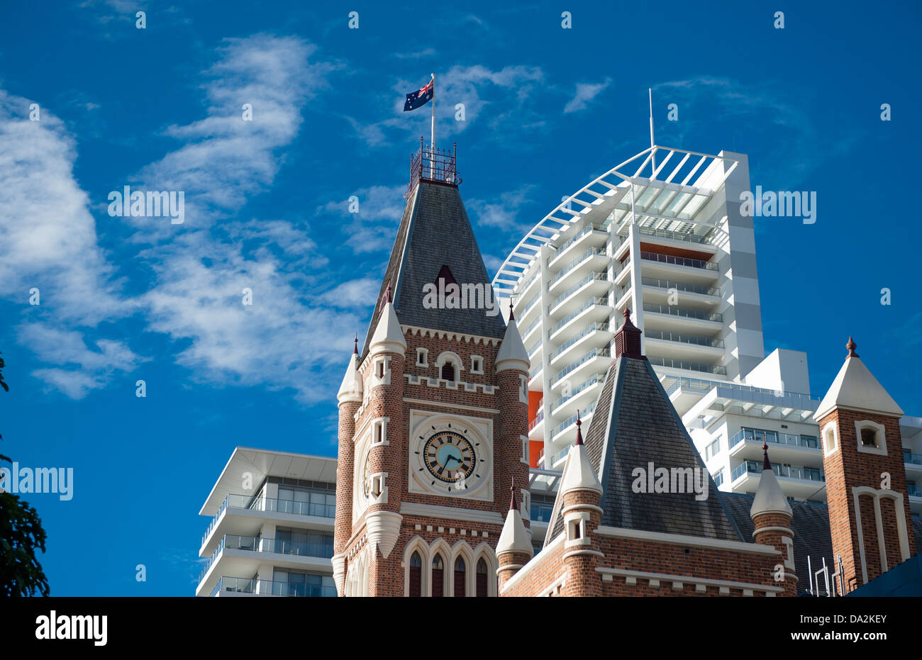 The tower of convict-built town hall at Hay Street against the facade of a modern skyscraper at Perth, Western Australia - Stock Image