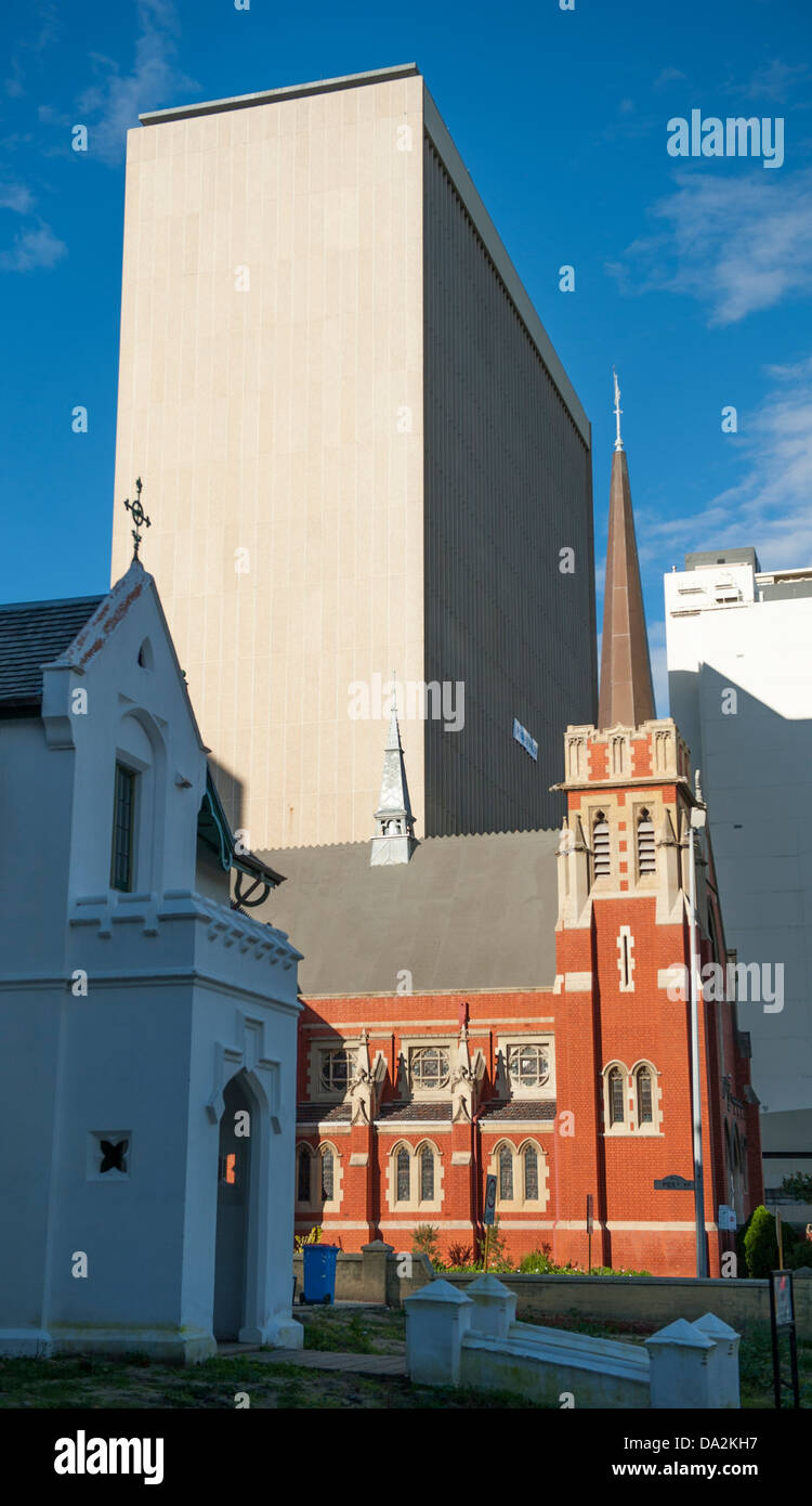 A modern office block contrasts with the old red brick of a church on Georges Terrace in the CBD of Perth, Western - Stock Image