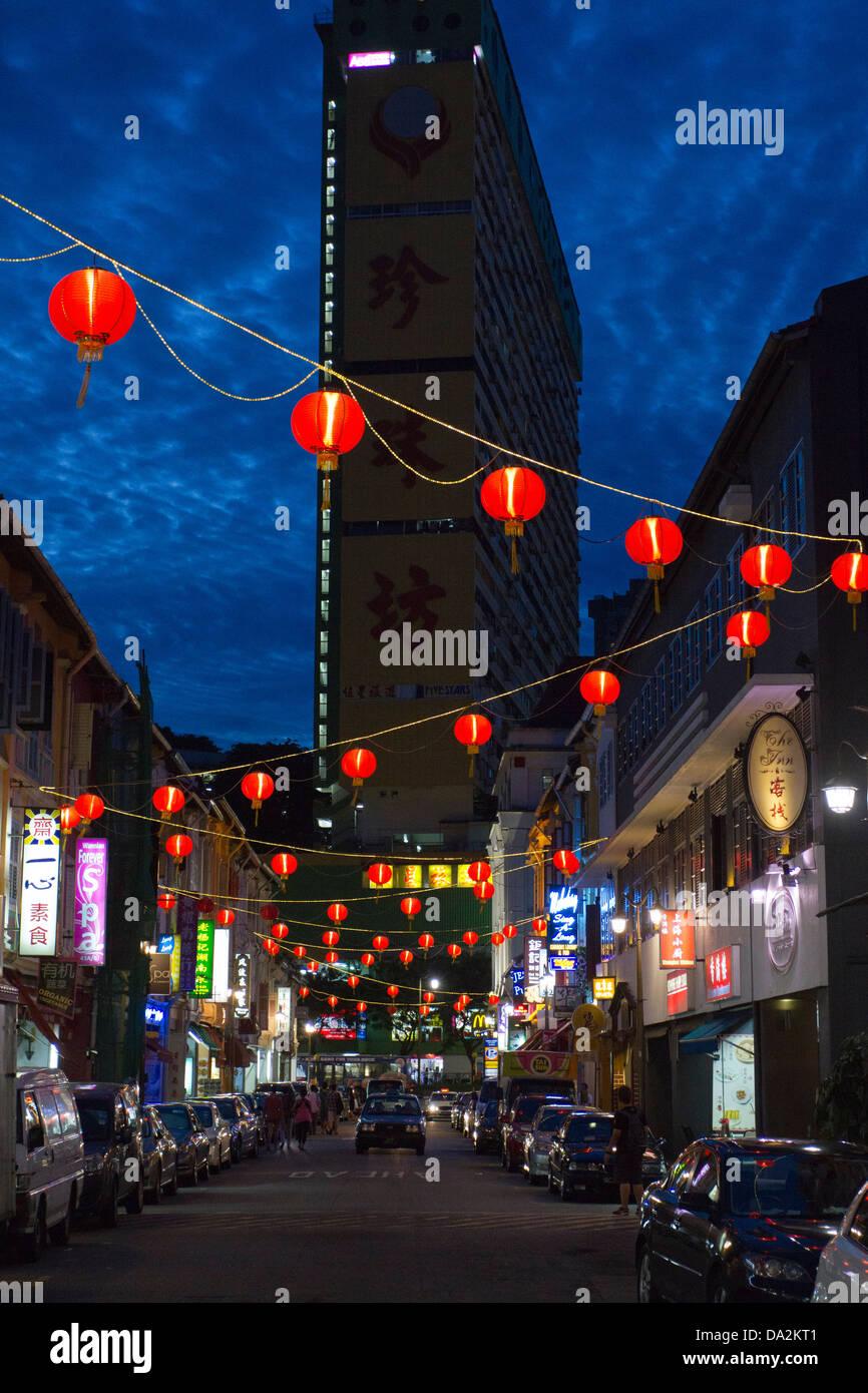 Singapore Chinatown at night/dusk showing lit red lanterns, Singapore, Asia - Stock Image