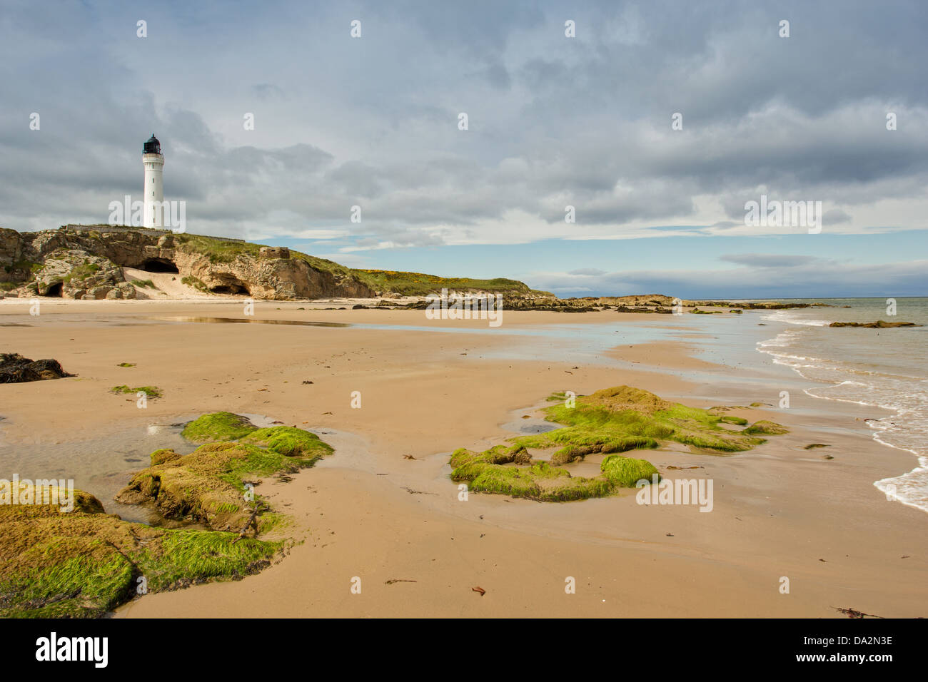 COVESEA SKERRIES LIGHTHOUSE ON THE ROCKS FROM THE BEACH NEAR LOSSIEMOUTH MORAY SCOTLAND - Stock Image