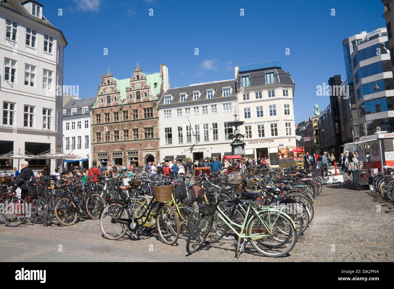 Copenhagen Denmark EU Rows of bicycles parked in Amagertorv with the Stork Fountain - Stock Image