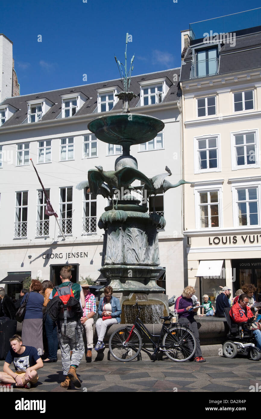 Copenhagen Denmark EU Stork Fountain dominates the very busy Amagertorv the Central Square - Stock Image