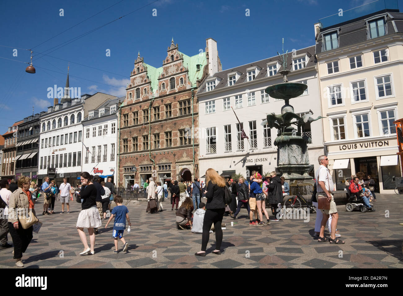 Copenhagen Denmark EU Stork Fountain dominates the very busy Hojbro Plads the Central Square - Stock Image