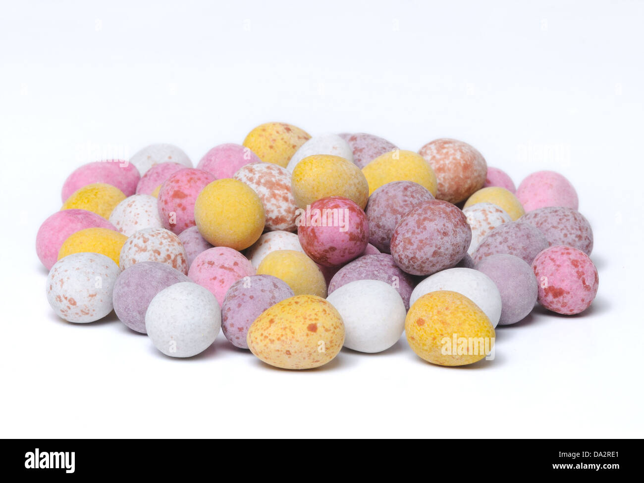 A shot of a pile of mini chocolate easter eggs on a plain white background. Stock Photo