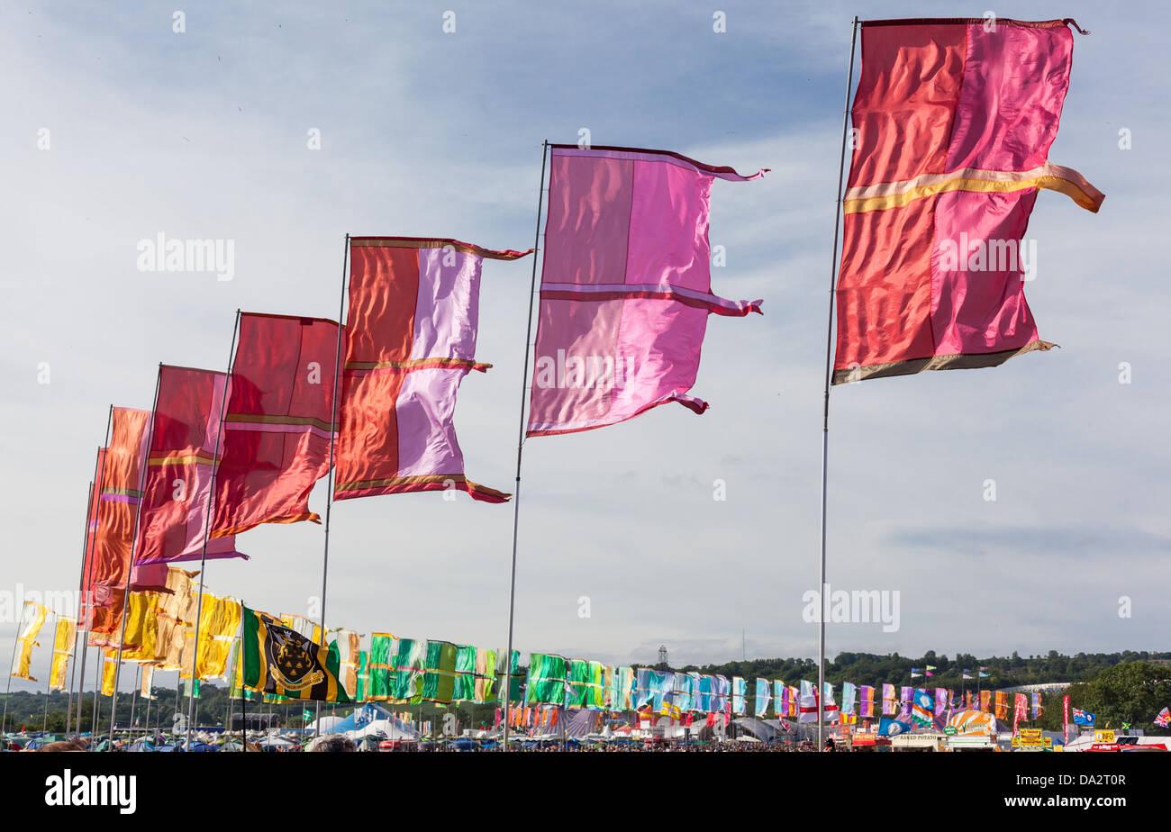 GLASTONBURY FESTIVAL, UNITED KINGDOM - JUNE 30 2013 : Multi-Coloured Flags Flapping in the wind at Glastonbury Festival - Stock Image