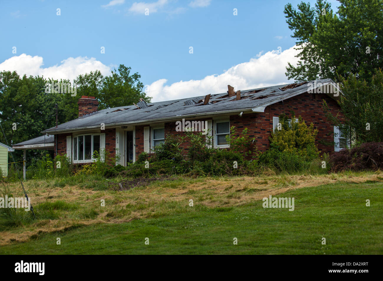 Do not cross Police Line at abandoned house. - Stock Image