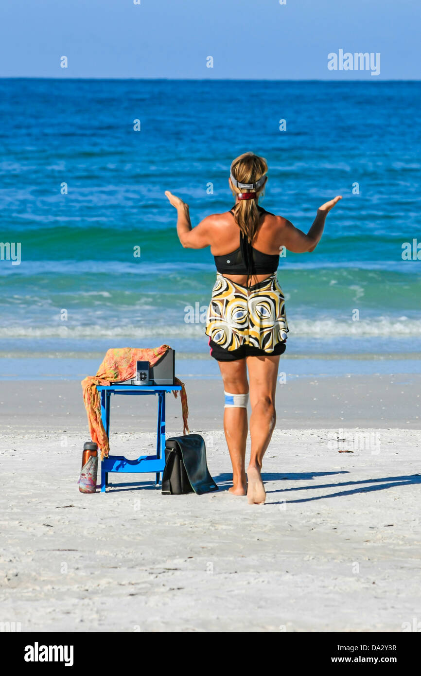 Women exercising the mind and body on the beach using the Nia technique Stock Photo
