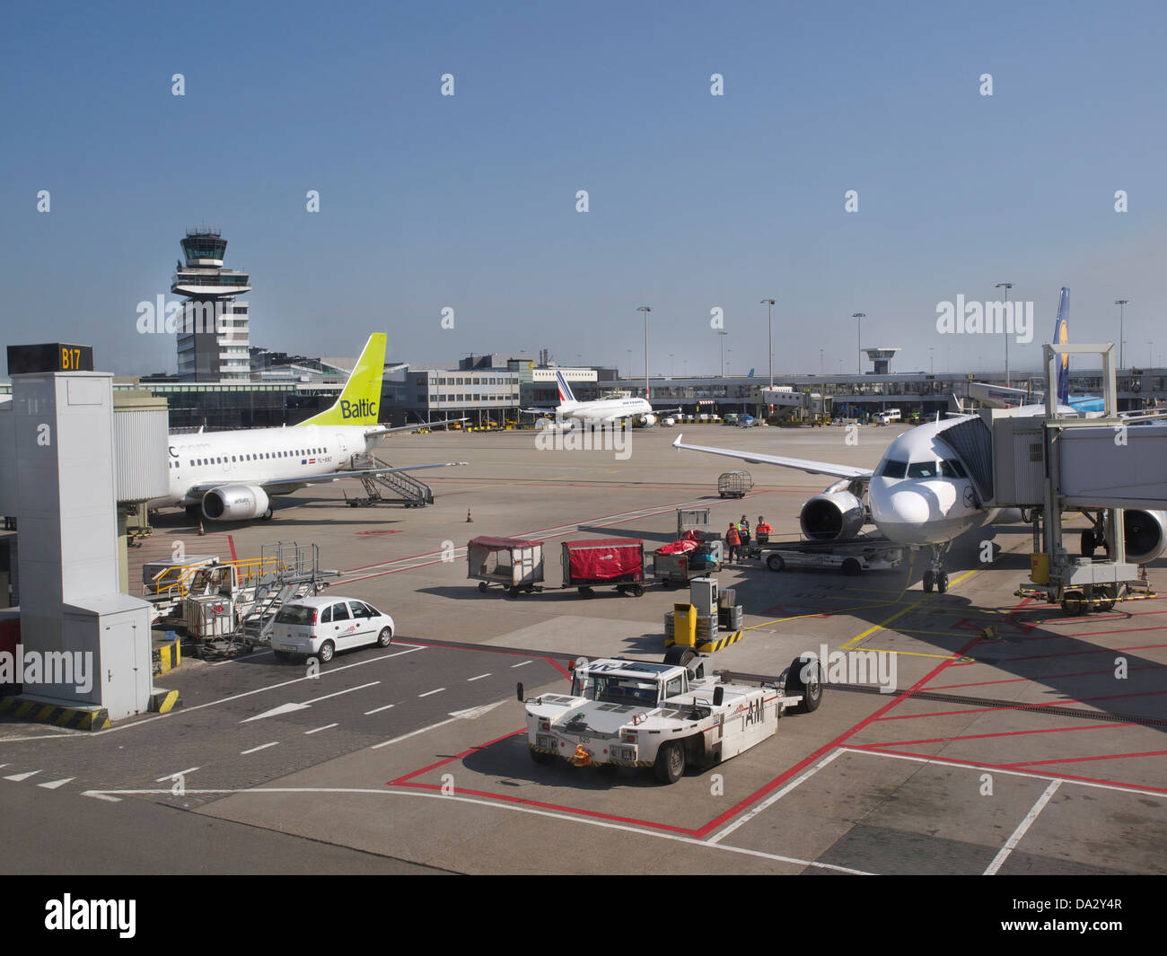 various aeroplanes on the deck at the Lisbon airport, with ground personnel doing checks. Portugal - Stock Image