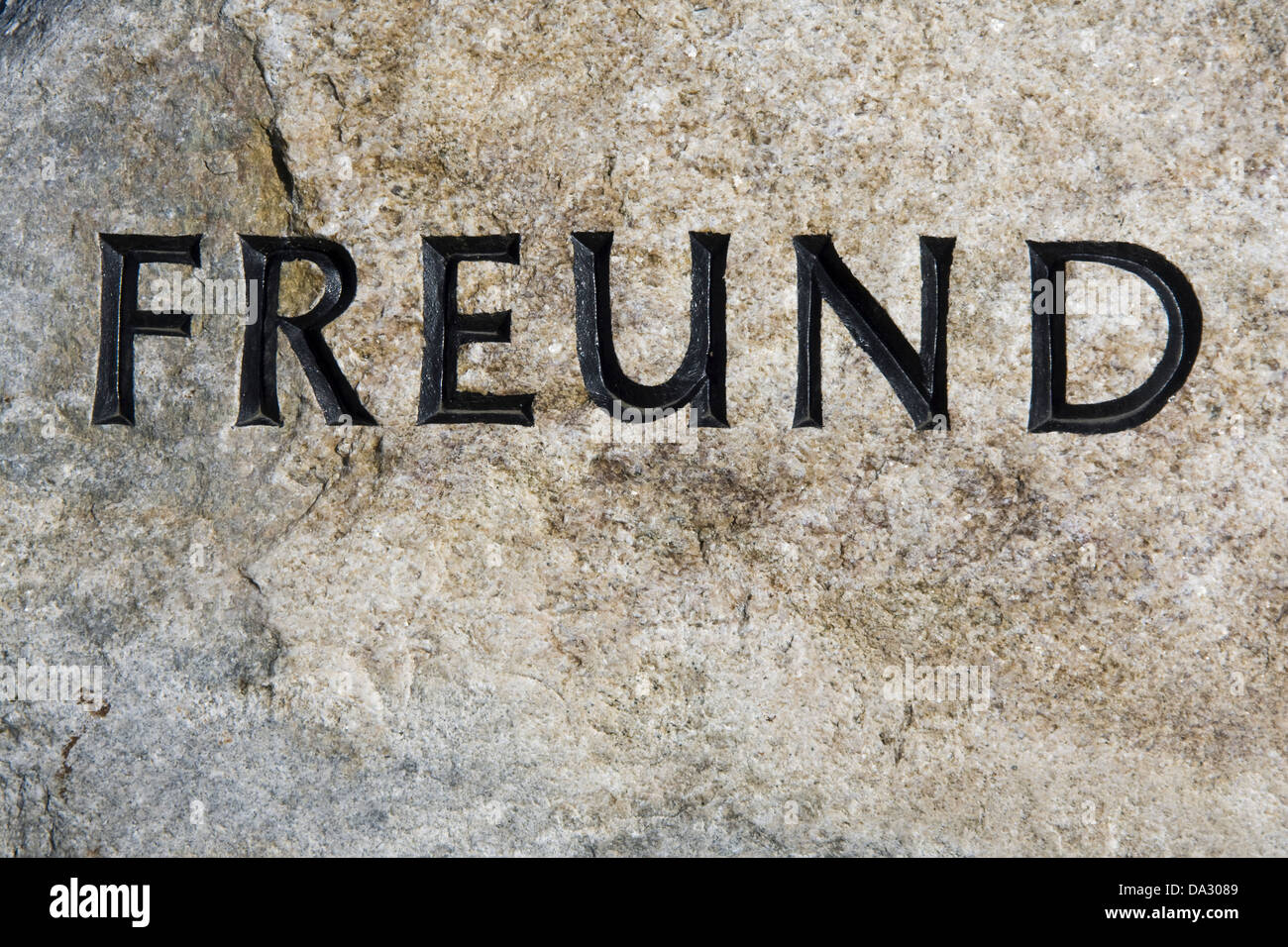 grave inscription friend on a german cemetery - Stock Image