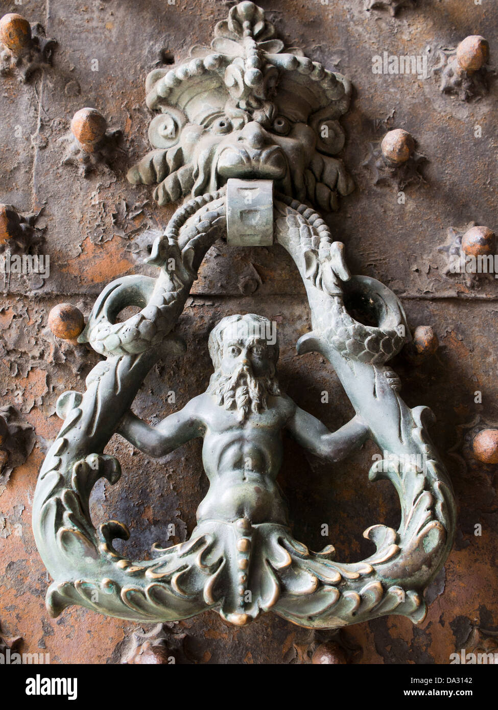 Elaborate door and knocker to the Palazzo Ducale in Genoa, Italy 3 - Stock Image