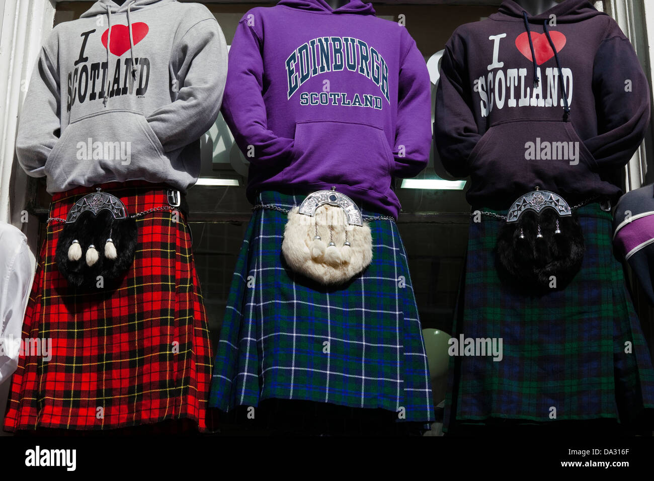 Manikins in a shop in Edinburgh displaying kilts, sporrans and sweat shirts that promote Edinburgh and Scotland, - Stock Image