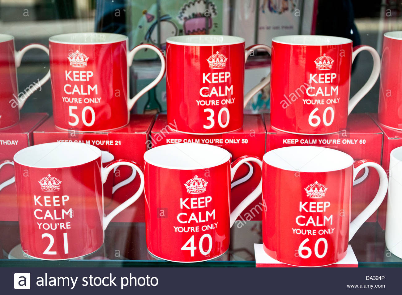 Keep calm mugs for different age birthdays displayed in a shop window, London, UK - Stock Image