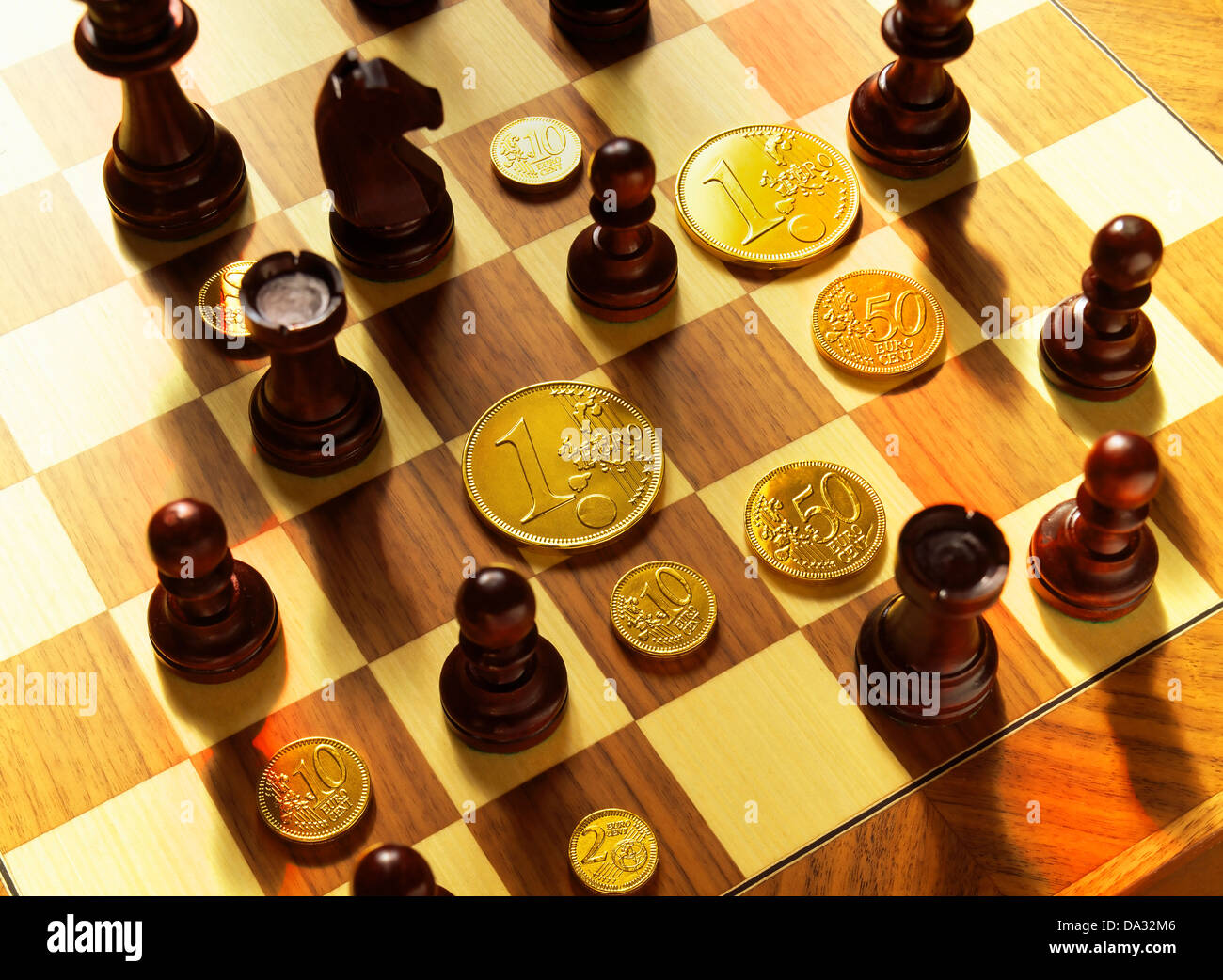 Chessmen And Golden Euro Coins On Chessboard Stock Photo 57845654