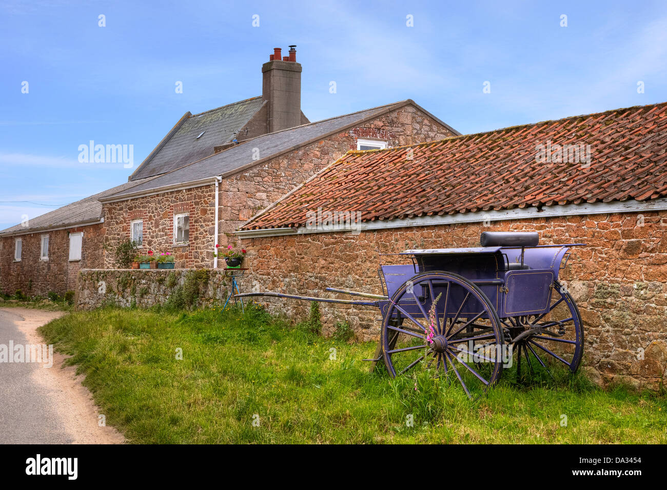 old farmhouse with carriage on Jersey, United Kingdom - Stock Image
