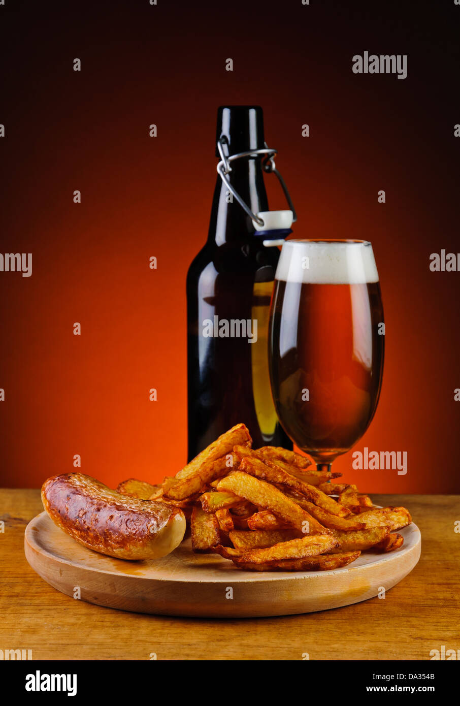 grilled sausage, french fries and fresh beer Stock Photo