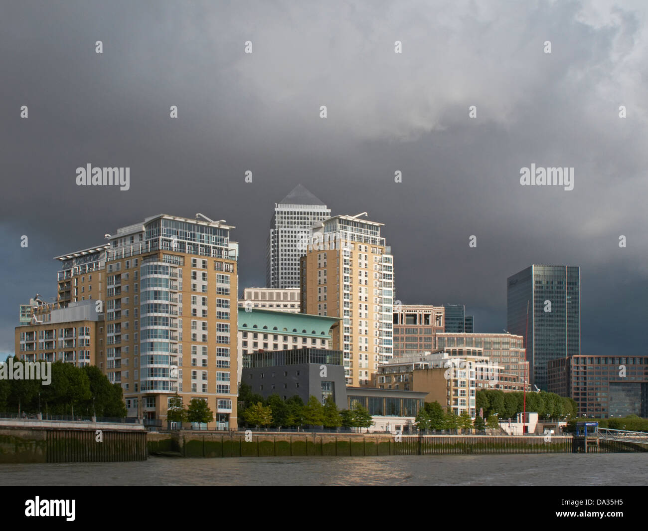 London Docklands and Canary wharf from the river Thames - Stock Image