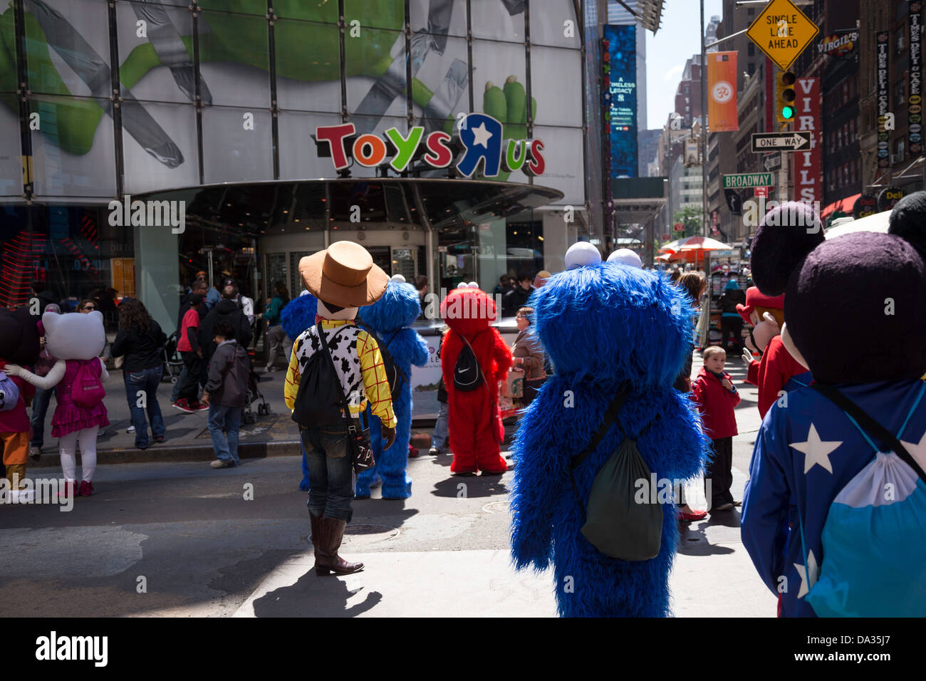 cartoon characters in front of toys r us in times square nyc stock