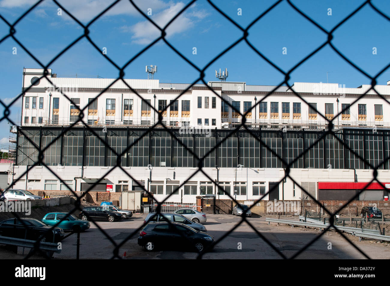 Car park and British Postal Museum through fence, Holborn, London, UK - Stock Image
