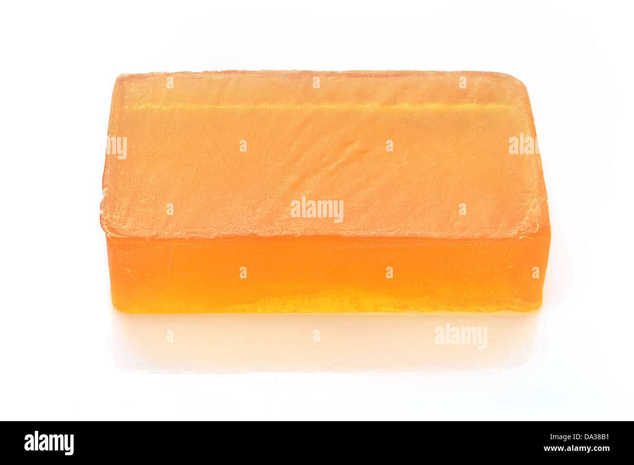 Orange handmade glycerin soap on white background. Hypoallergenic soap with marigold extract. Beauty care. - Stock Image