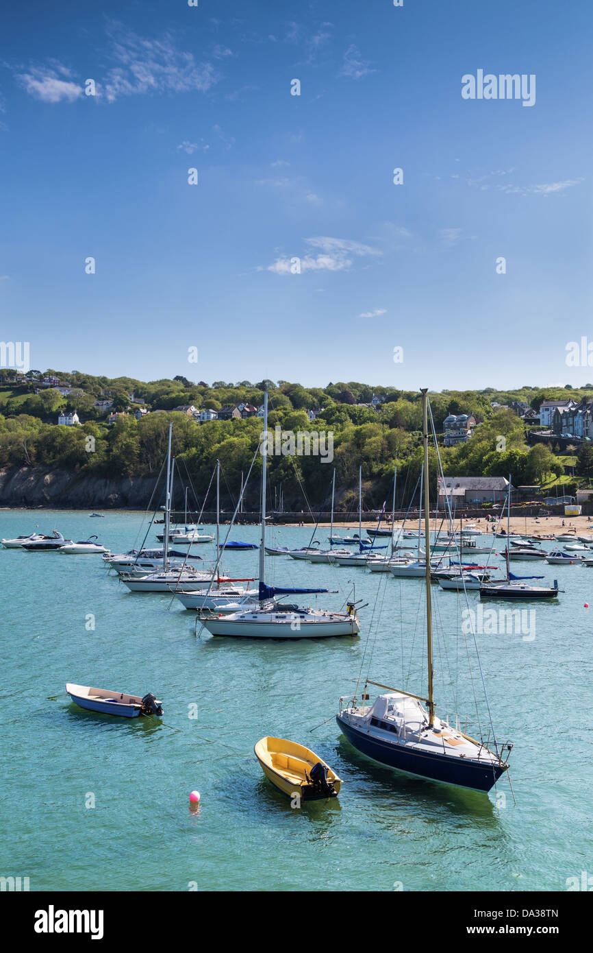 The Harbour at New Quay, Cardigan Bay Wales  with yachts floating at high tide. - Stock Image