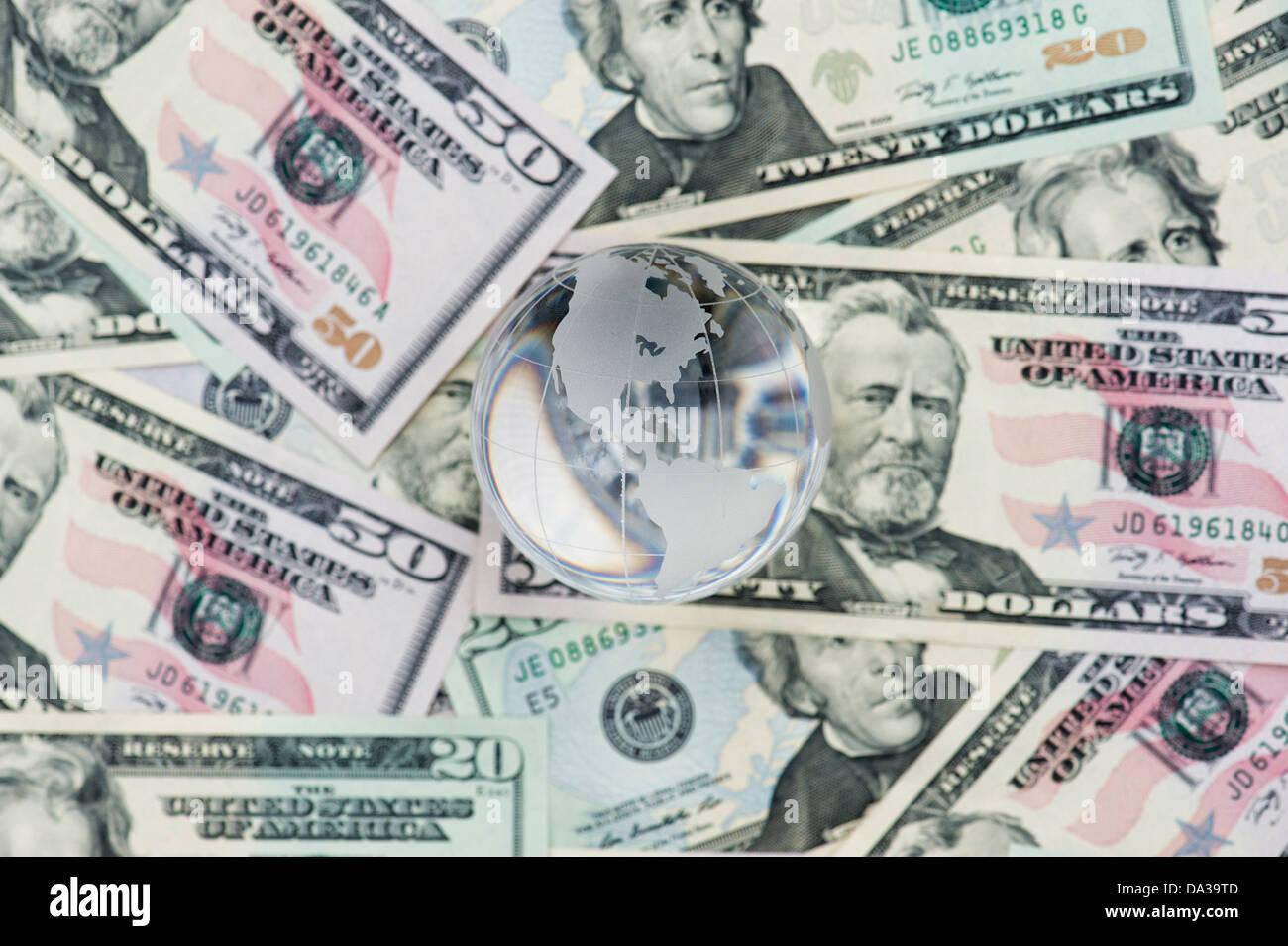 Glass Globe showing America on American dollar bills - Stock Image